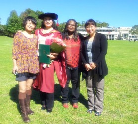 Dr Hongyan Yang on her graduation day surrounded by PhD friends Grace Chang, Vera W. Tetteh and Li Jia